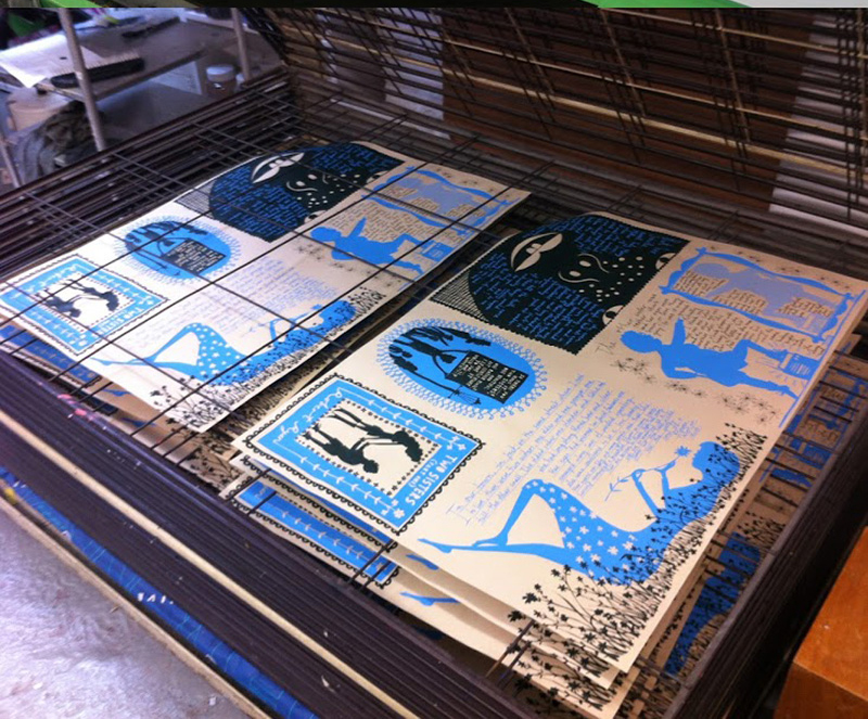 Multiple colour prints drying on the rack