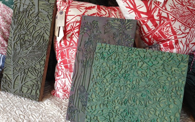 A selection of blocks by Susie Heatherington, with some of her finished printed fabrics made into cushion covers