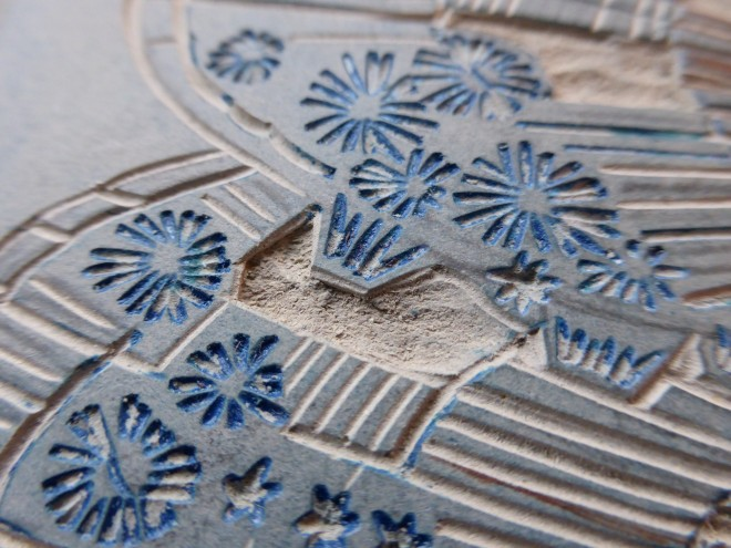 Alison Deegan: Close-up of carved lino midway through the reduction lino print Mussels and Barnacles
