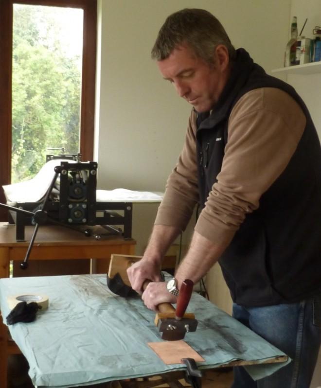 Clive Riggs in his studio rocking a copper plate