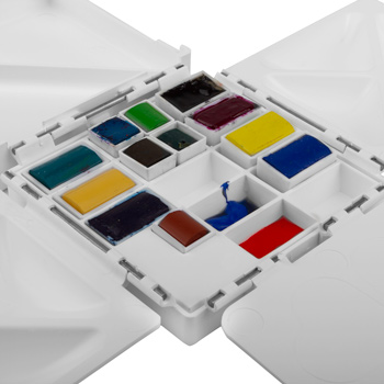 The Cloverleaf paintbox 's deep wells are designed for squeezing in your tube paint. Note: paint is not included.