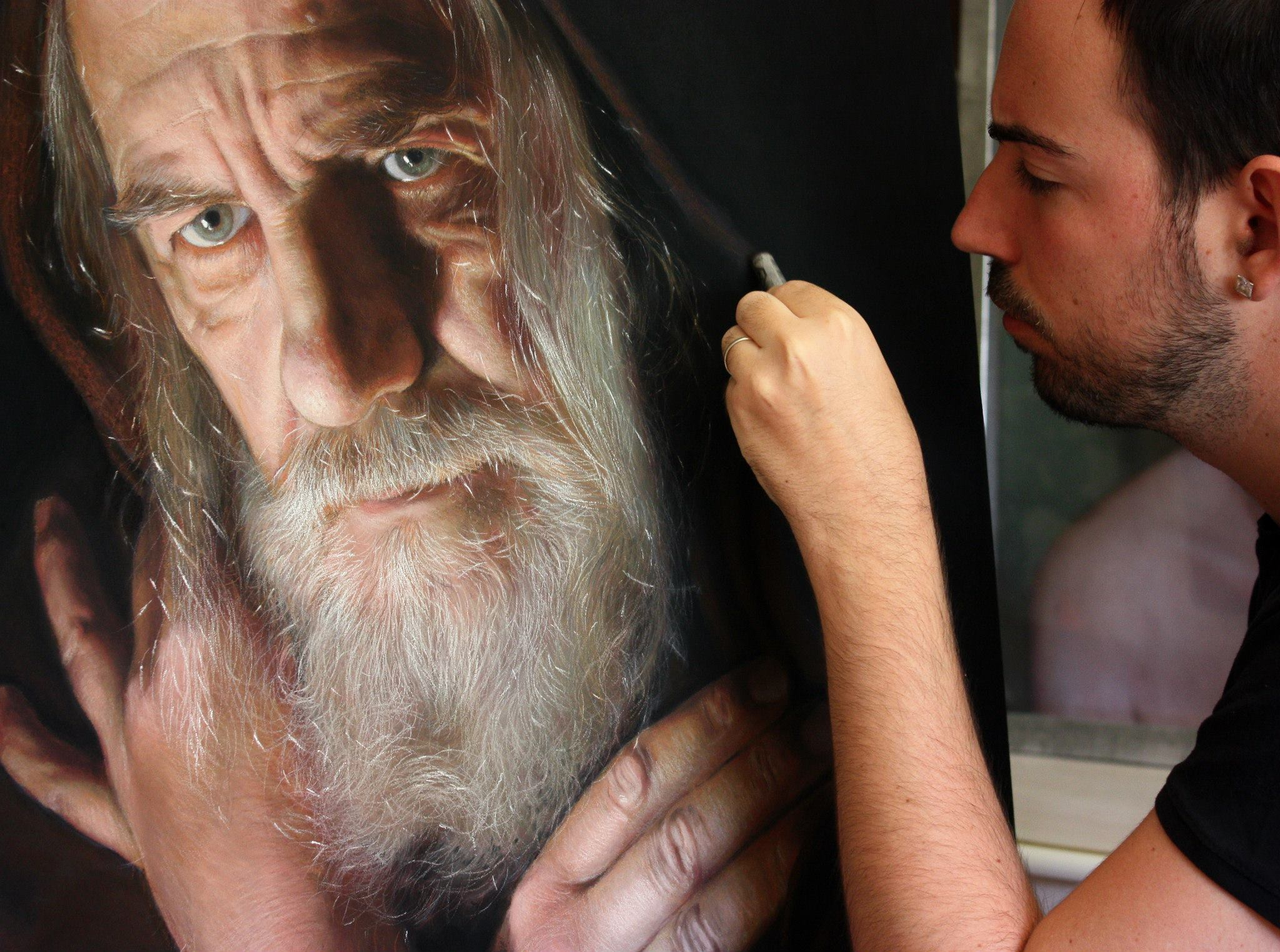 Ruben Belloso Adorna working on La Soledad del Genio (The solitude of the genius) Pastel on wood panel 100x70cm