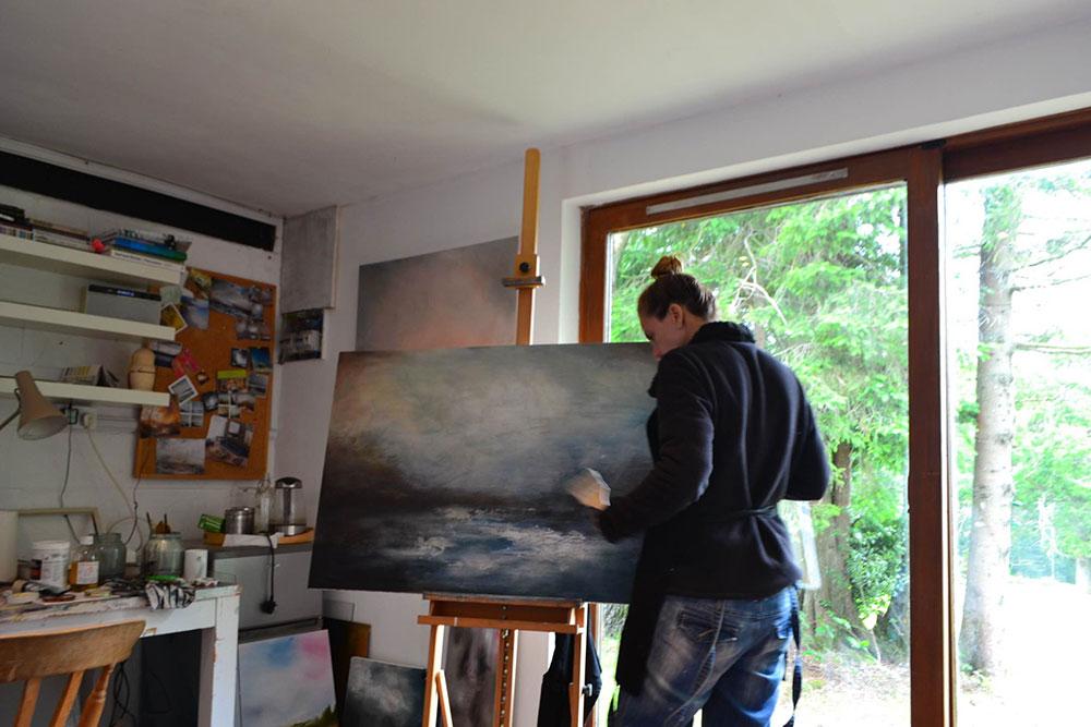 Liesha Yaz painting in her studio
