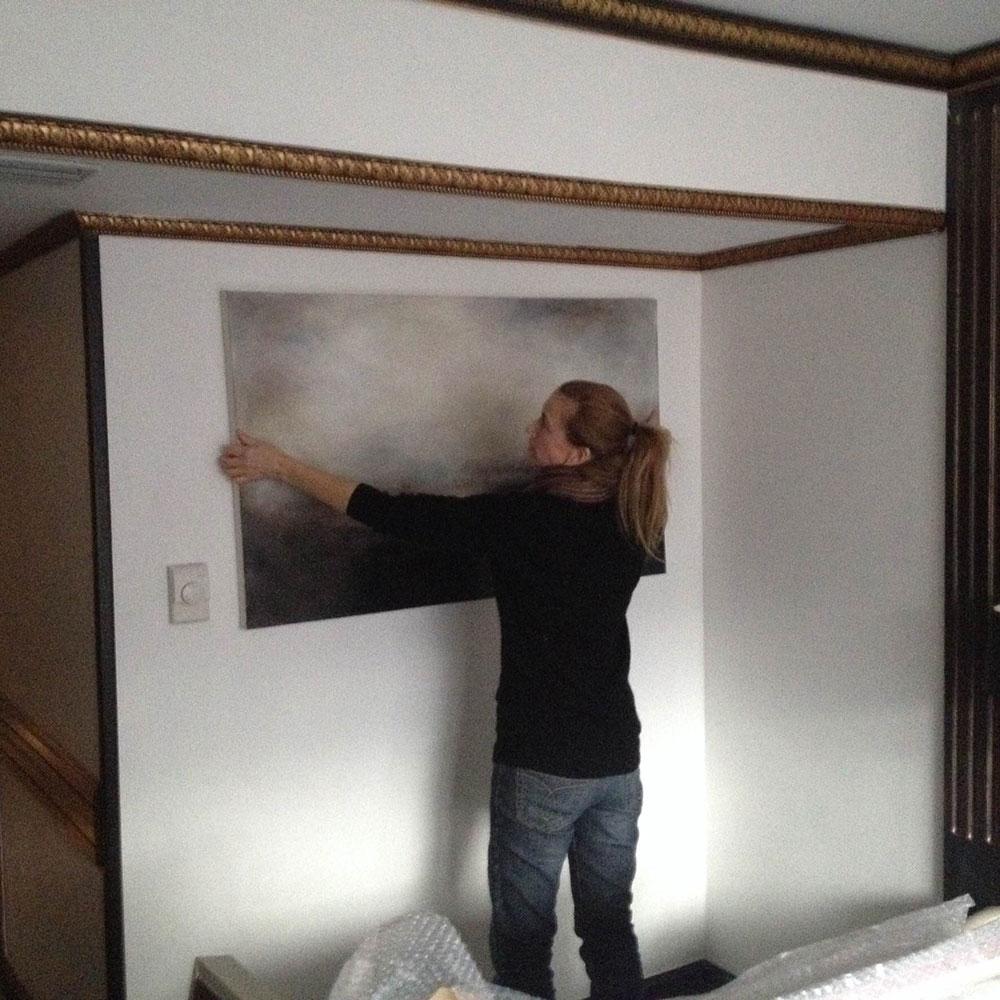 Liesha Yaz hanging her paintings at Artrooms 2016