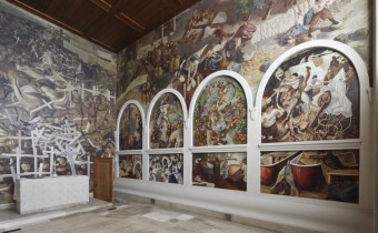 The south wall paintings, and altar and east wall with THE RESURRECTION OF THE SOLDIERS, by Stanley Spencer (1891- 1959) at Sandham Memorial Chapel, Burghclere, Hampshire. Image courtesy of National Trust Images/ John Hammond/ the Estate of Stanley Spencer