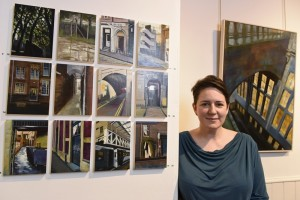 Artist Lindsey Lavender pictured with some of her work. Photo by Andy Thompson