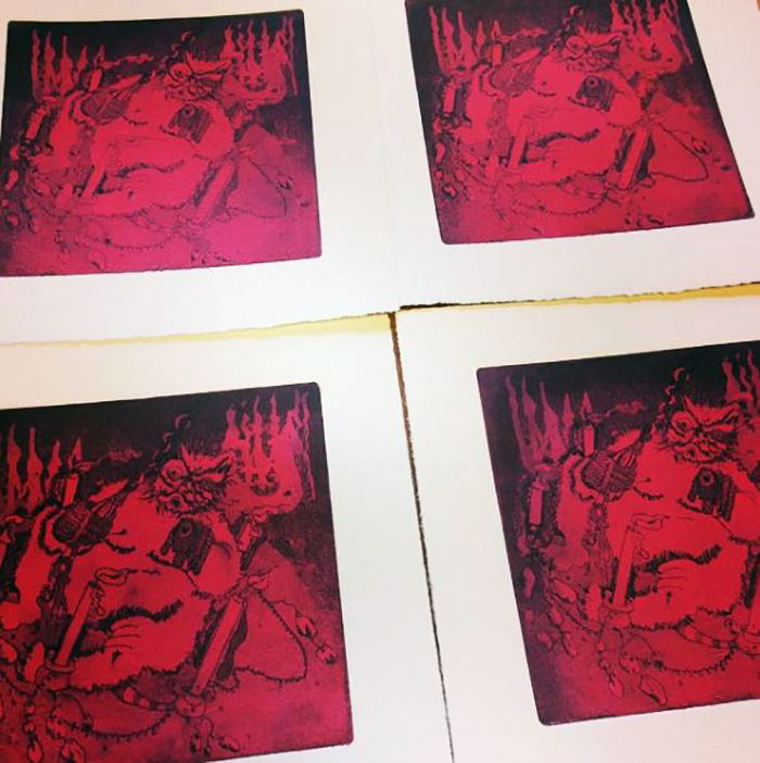 Anna Johnson's etched prints in the studio.