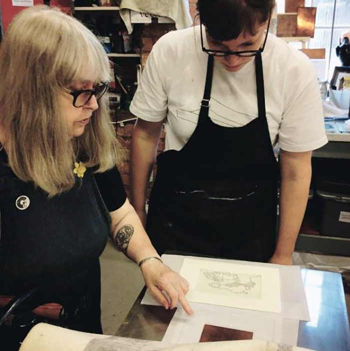 Founder of Green Door Printmaking Studio, Anna Johnson discussing plate tone foul biting during an etching session at Green Door Printmaking Studio, Derby.