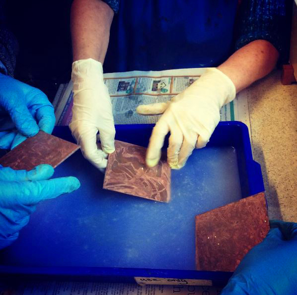 Washing off the soap ground during at etching course at Green Door Printmaking Studio, Derby.