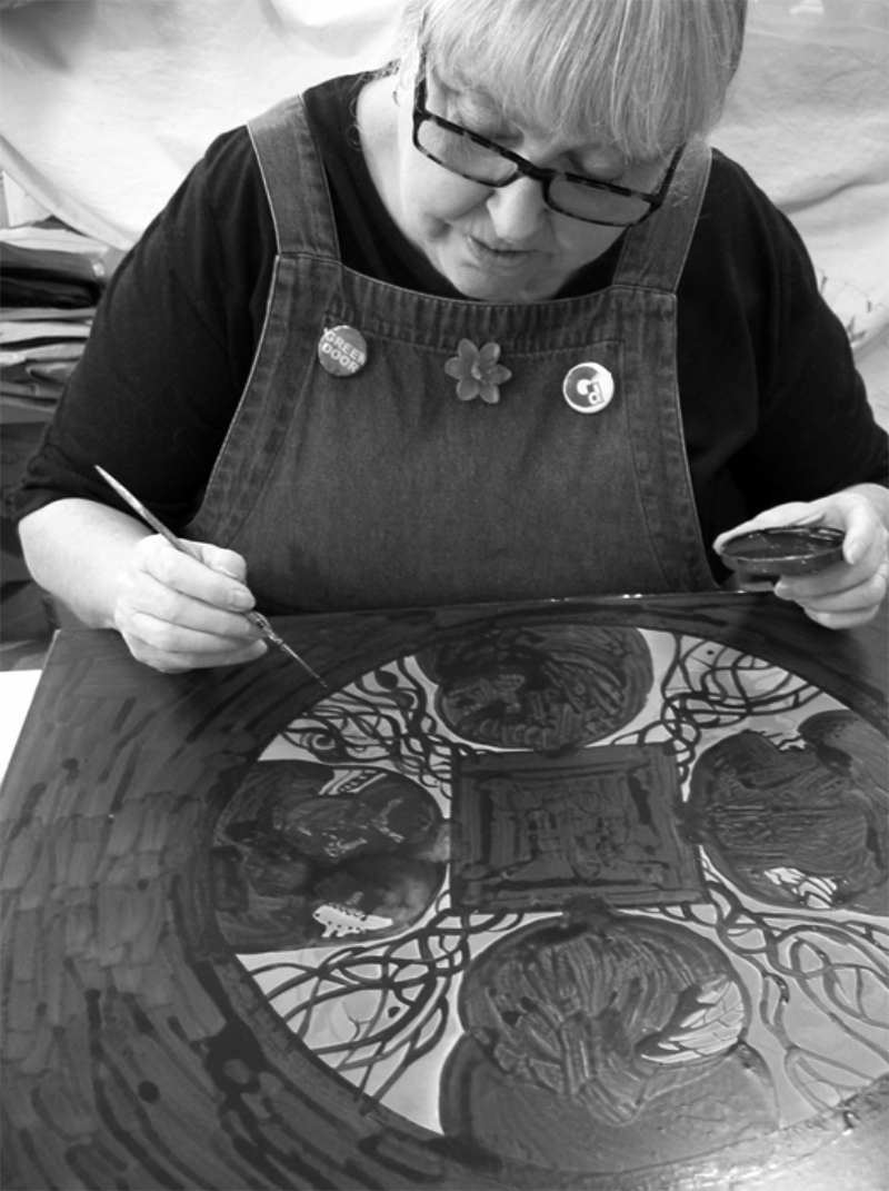 British artist and founder of Green Door Printmaking Studio Anna Johnson working on a plate for her 'Anima'