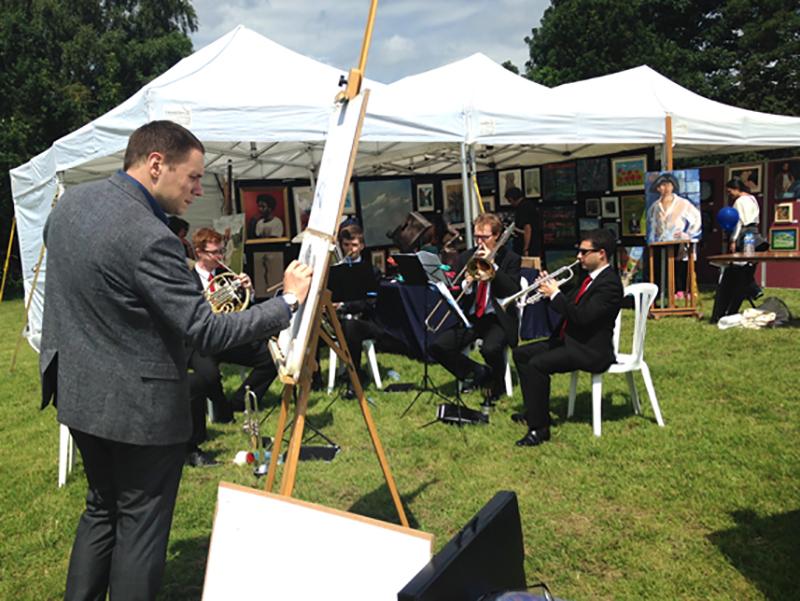 Artist John Close draws the Kensington Brass during the Hampstead Art Fair Day