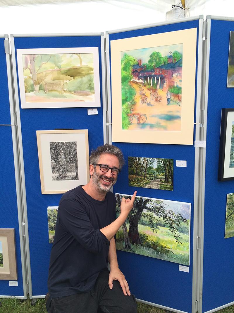 British comedian and writer David Bladdiel alongside Patricia Trautman's winning artwork