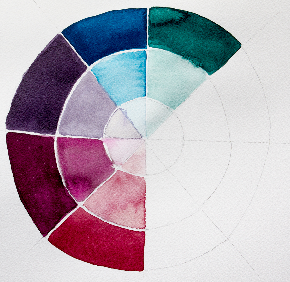 A colour chart of the Liquitex Muted Collection colours Inks. The outer ring is full strength the two inner rings have progressively more water added.