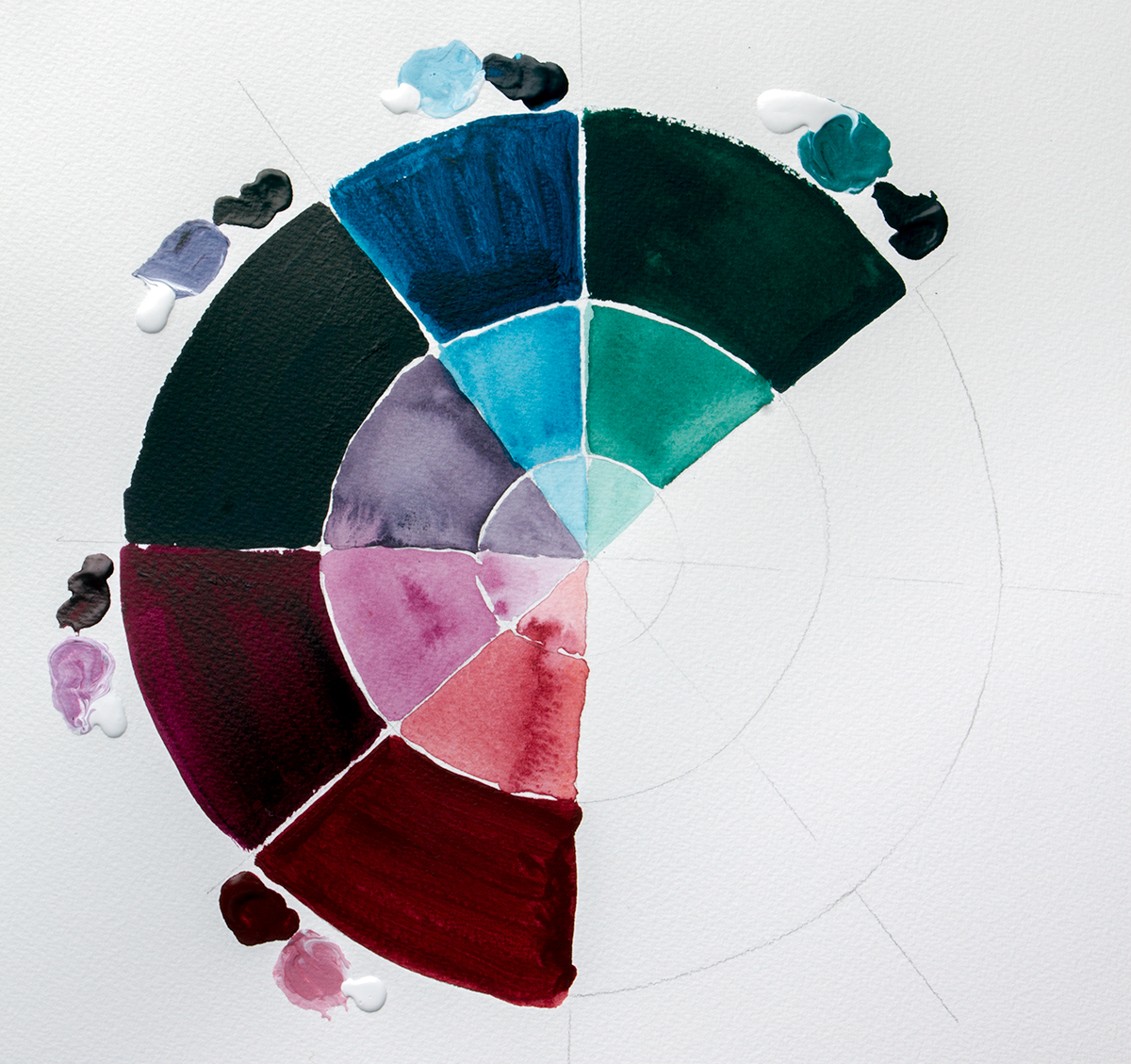 A colour chart of the Liquitex Muted Collection colours in Soft Body. The outer ring is full strength the two inner rings have progressively more water added. The blobs on the outside show the thickness and the colour when mixed with titanium white.