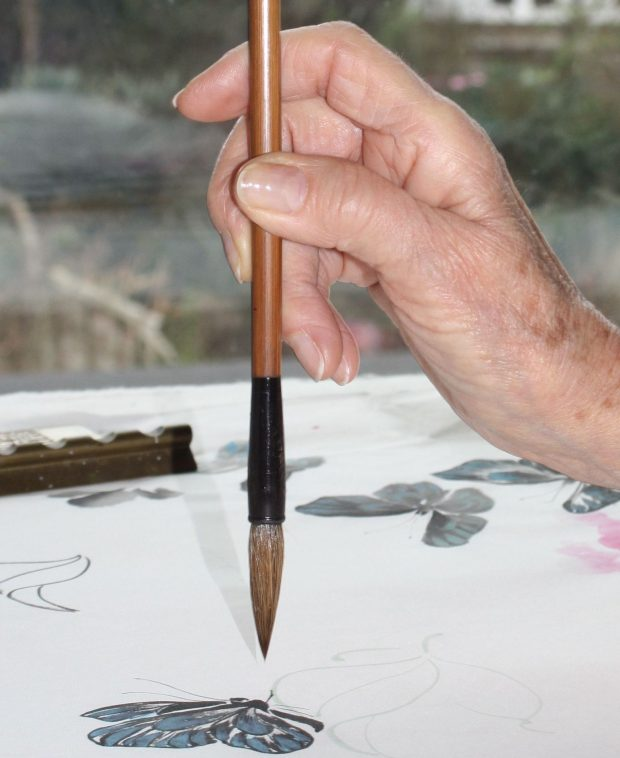 Holding a Chinese Painting brush