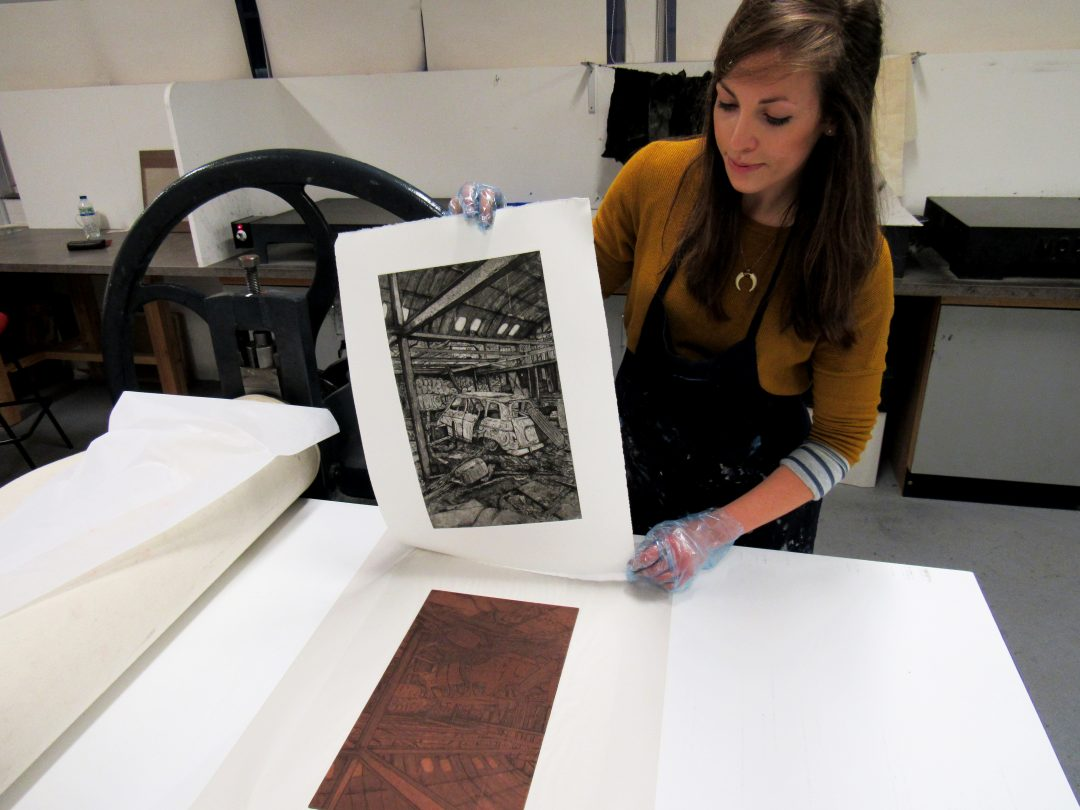 Jemma Gunning revealing her print once the plate has gone through the press