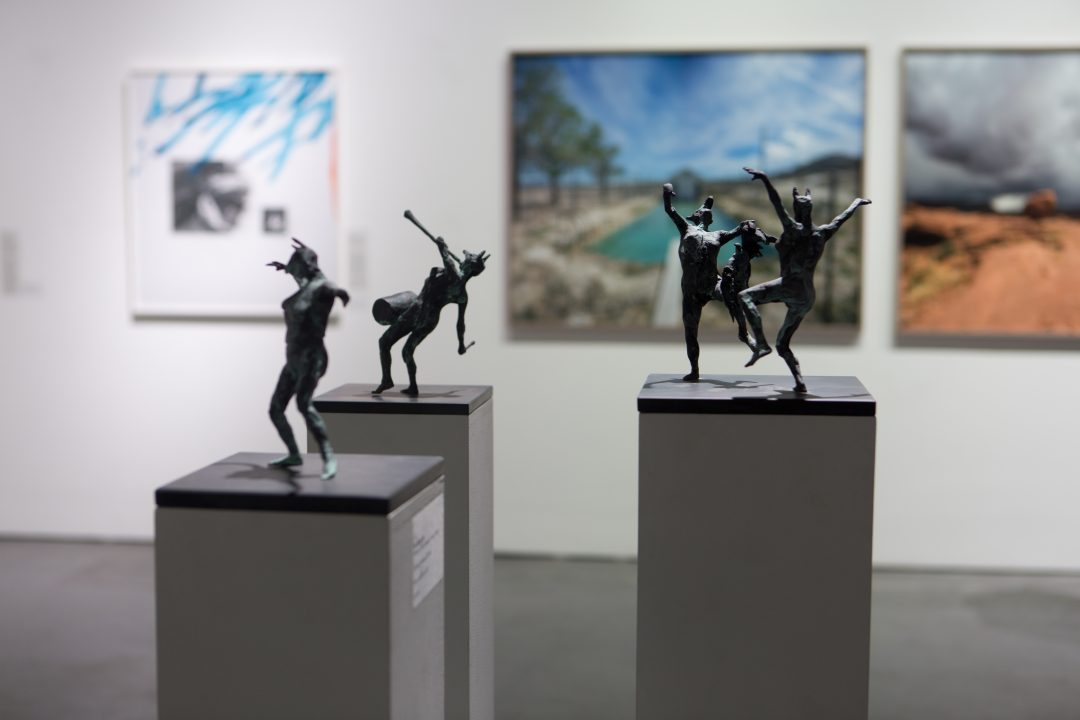 Installation shot, 'By Popular Demand', Mall Galleries, London 2017 ('Two Maenads with Bird', 'Maenad with Drum' and 'Dancing Maenad' by Tim Shaw RA (foreground), 'Others 21' by Aishan Yu (background left) and 'Tonopah NV' by Boyd and Evans (background right) )