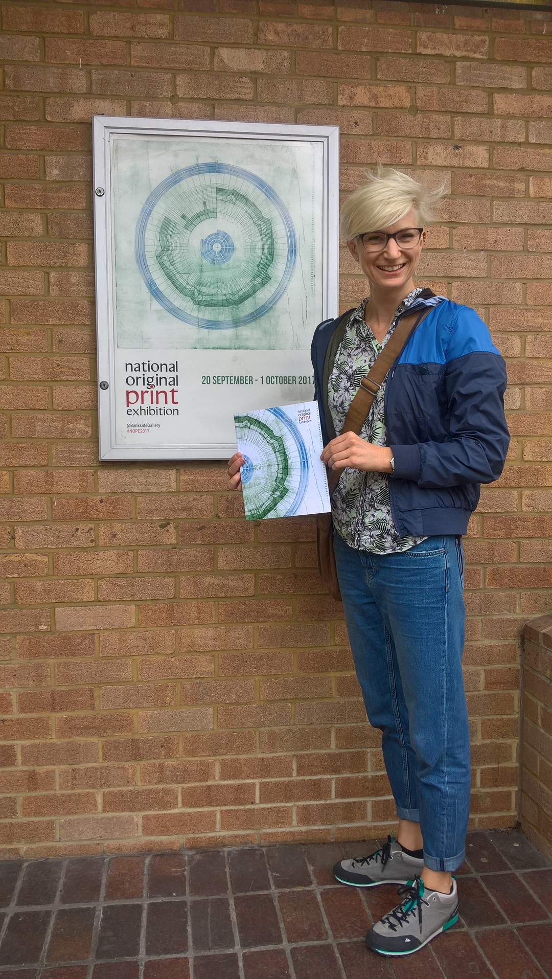 National Original Print Exhibition Bankside Gallery, London September 2017 Liz K. Miller with the exhibition catalogue and poster which featured an image of the artist's work 'Circular Score #5'
