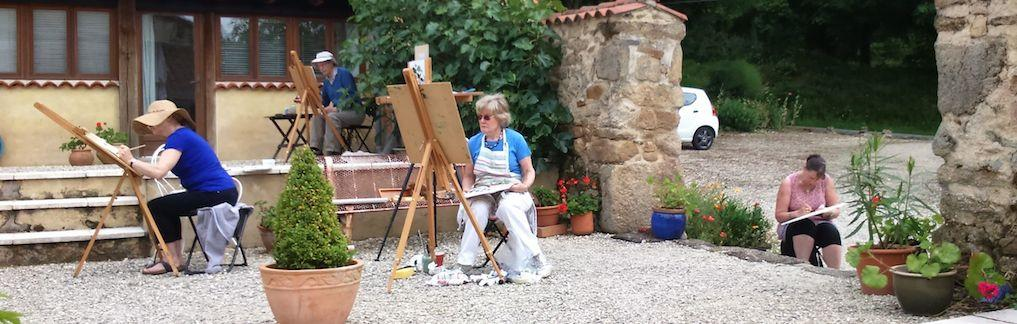 A group of artists painting in a courtyard during Linda H Matthews painting holiday in France.