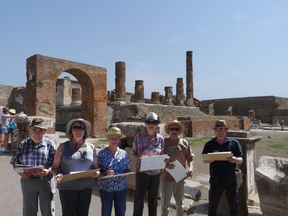 A Azenart Painting Holiday group of artists standing in front of the ruins of Pompeii