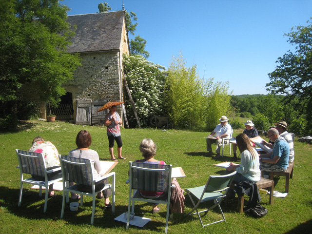 A group drawing a figure in the garden with Susie Home during a painting holiday in France