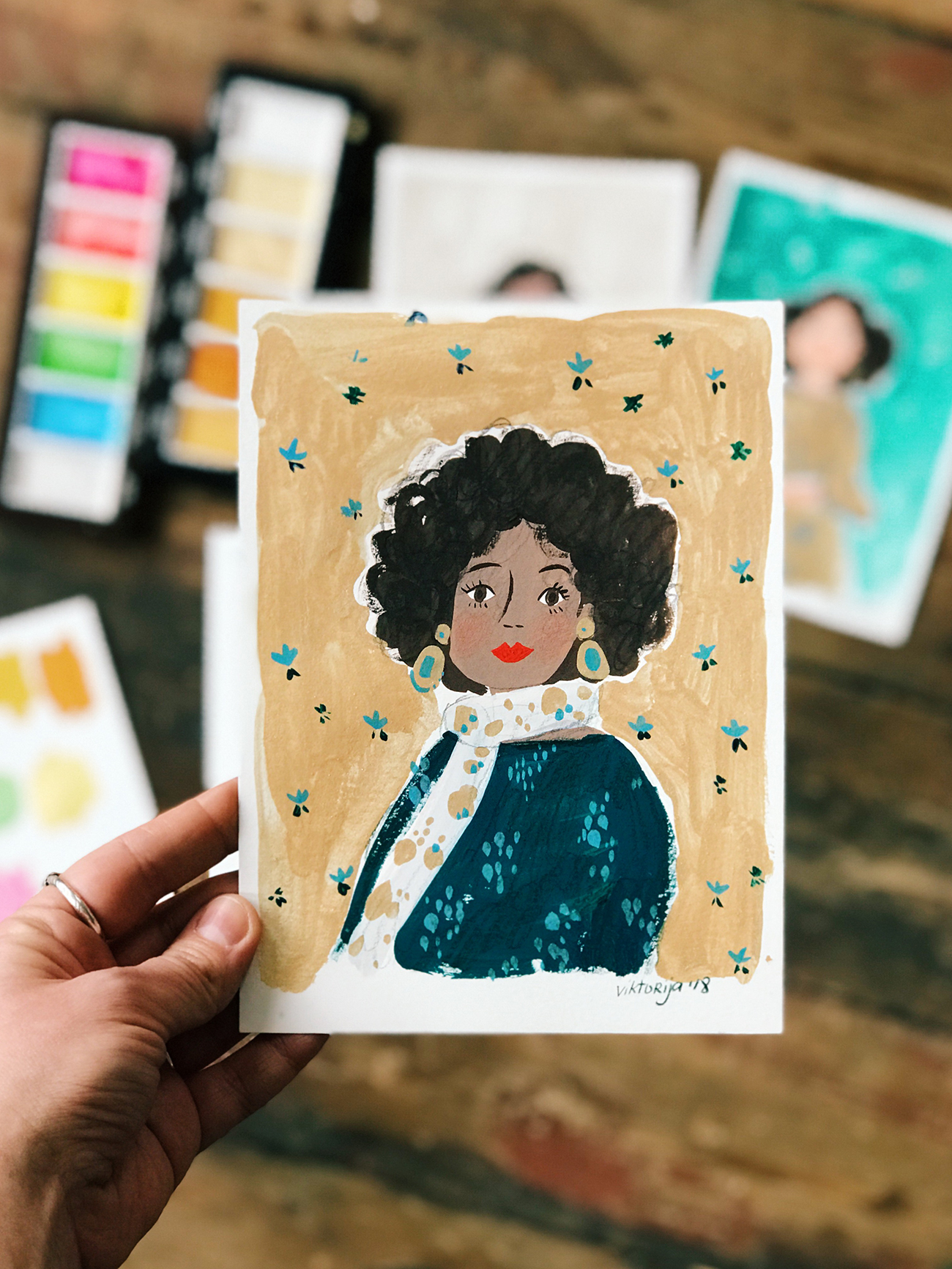 Viktorija Semjonova's illustration of a girl with a scarf using Kuretake Gansai Tambi Japanese Watercolour Pearl set and Kuretake Gansai Tambi Japanese Watercolour Starry set with Holbein Gouache.