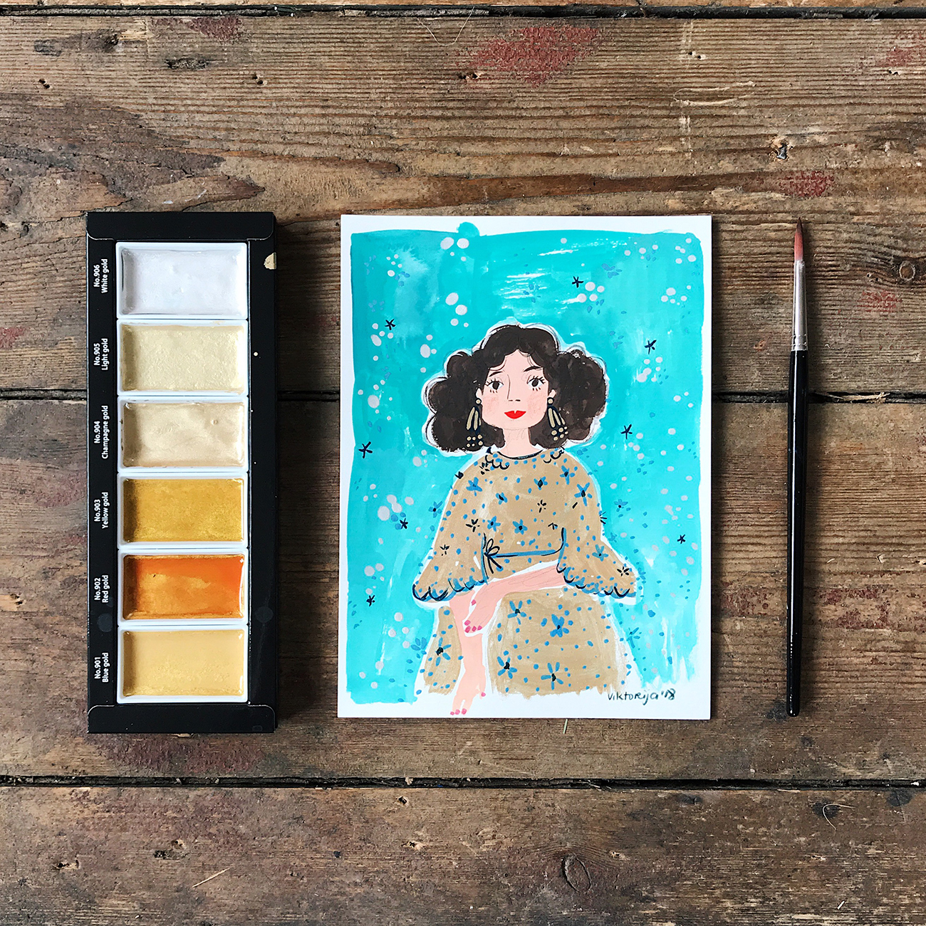 Viktorija Semjonova's drawing of a girl in a gold dress using Kuretake Gansai Tambi Japanese Watercolour Starry set and Holbein Gouache.