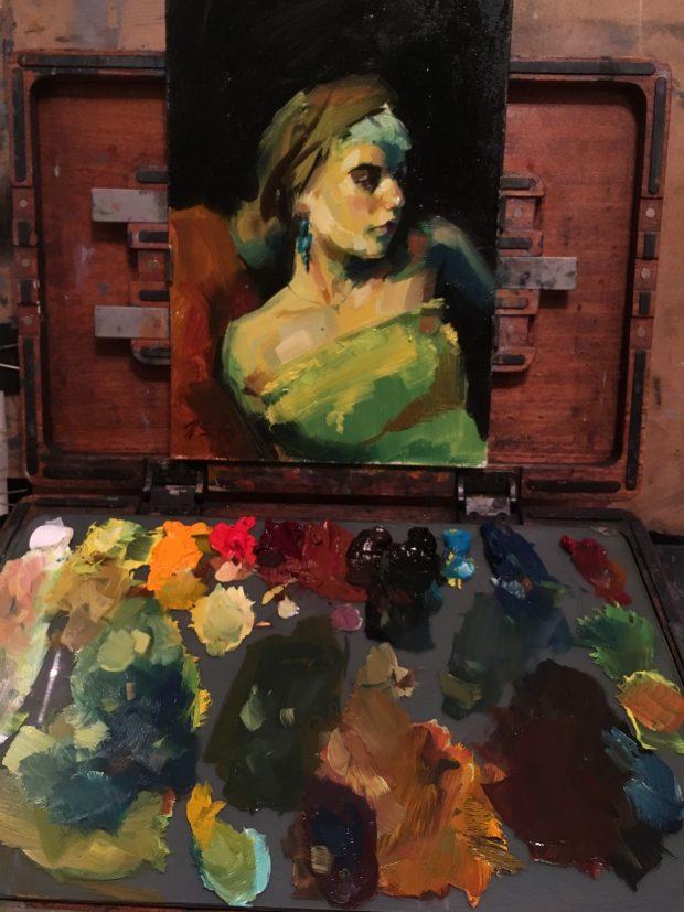 Thomas Golunski working on his piece including his palette