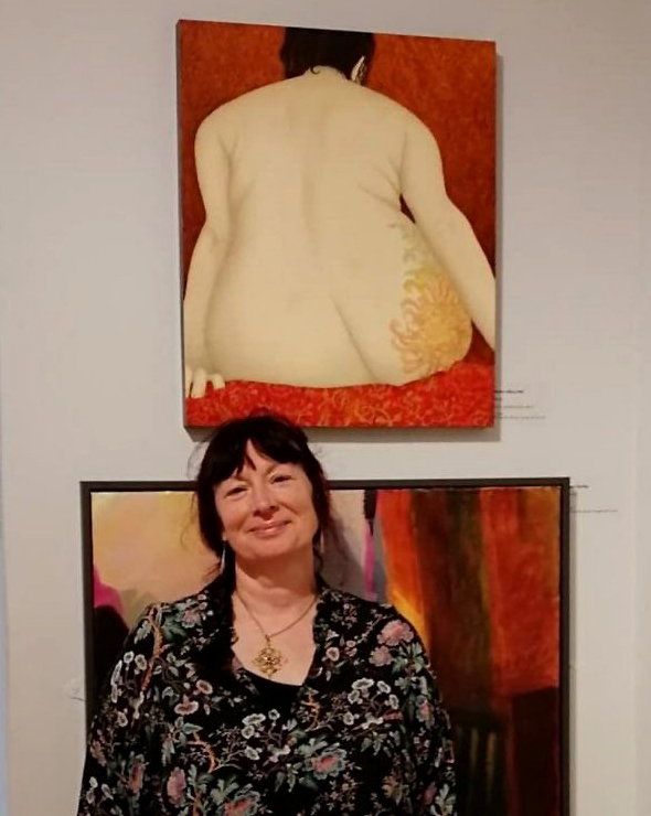 Sharron Astbury-Pettit at the NEAC Annual exhibition 2018 with her prize-winning painting 'Hanabi'