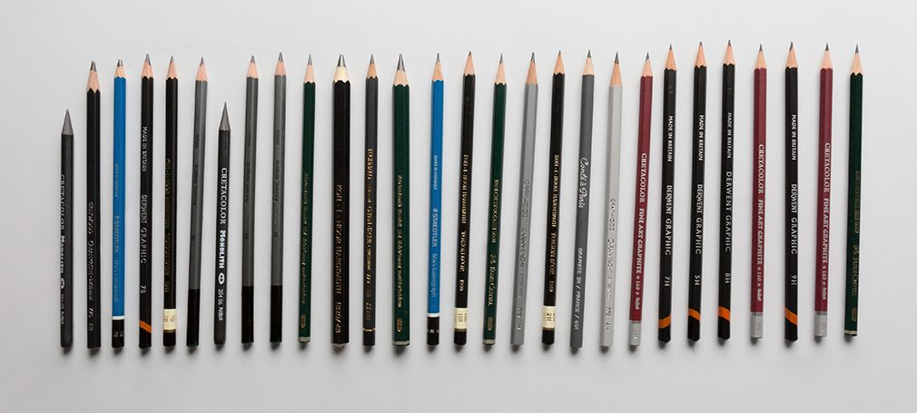 Graphite pencils demonstrating range of hardnesses from 9B-9H, difference between graphite and charcoal