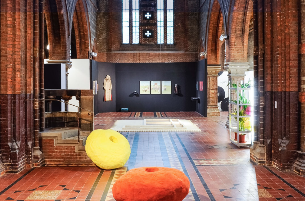 This is an image of the Florence Trust interior which has an gothic brown brick aesthetic and modern artworks throguhout
