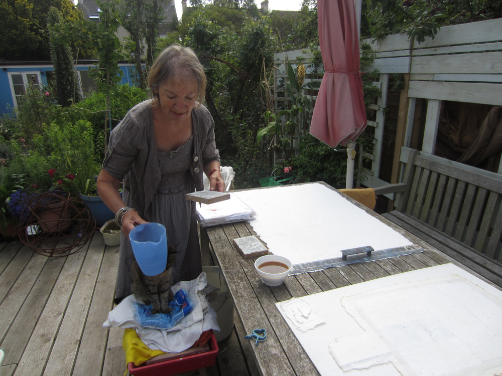 Jill Tattersall making paper with the cat