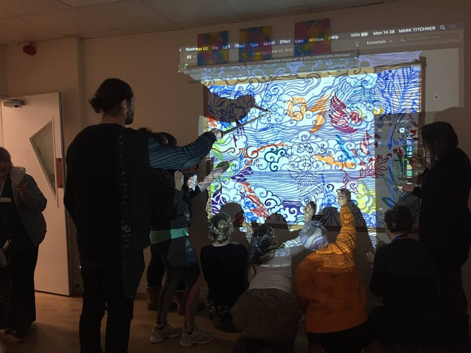 Mark titchner leading a group painting workshop for service users at a Mother and Baby unit...