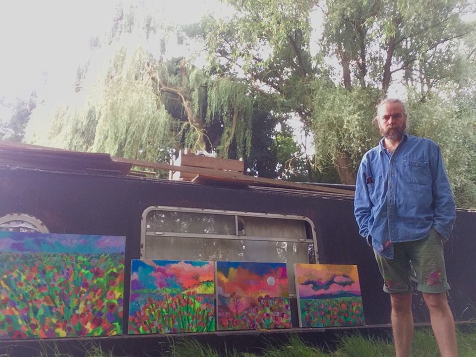 Paintings beside boat