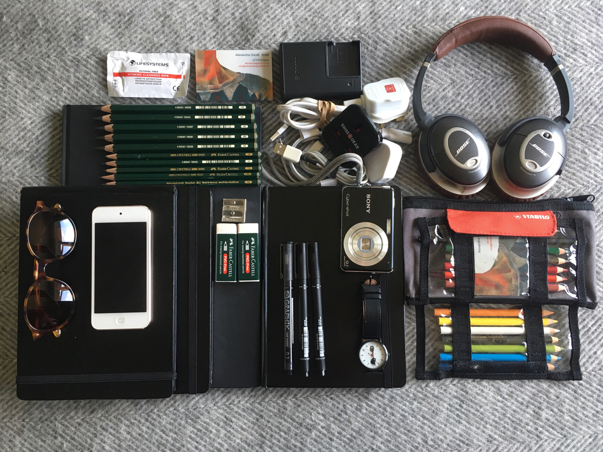 4 sketchpads, numerous pencils and fine tip pens, headphones, phone, camera and charging cables