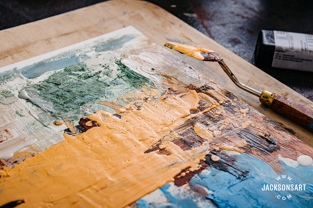 Encaustic wax being applied with a palette knife