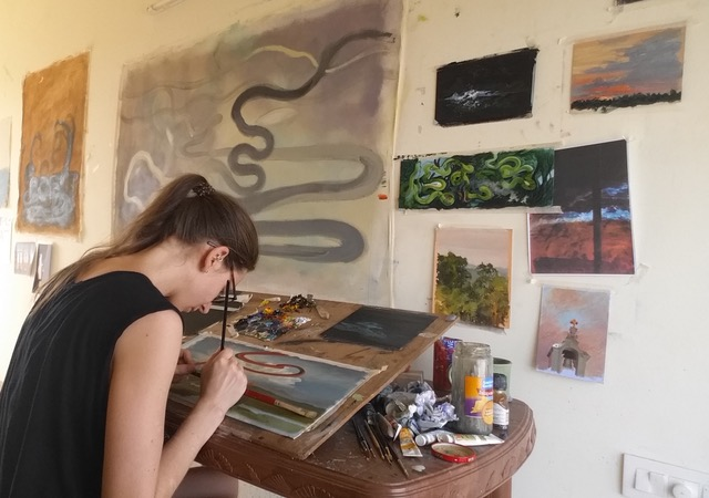 Photo of Tess Gray painting during a residency