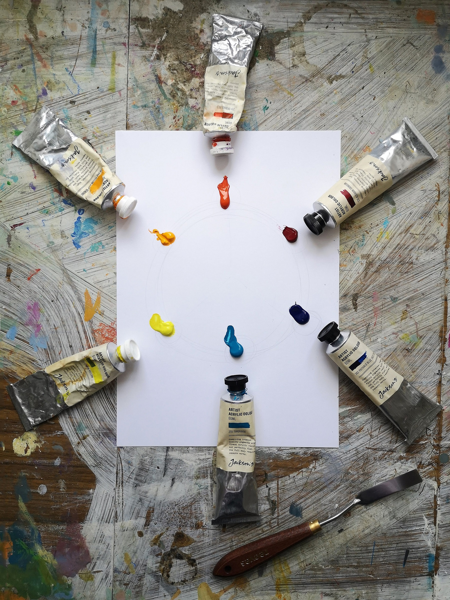A six colour primary palette comprising Orange/Red, Alizarin Crimson, Phthalo Blue, Turquoise, Lemon Yellow and Cadmium Yellow Deep Genuine